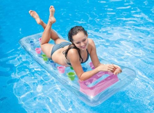 Matelas de piscine transparent à poches